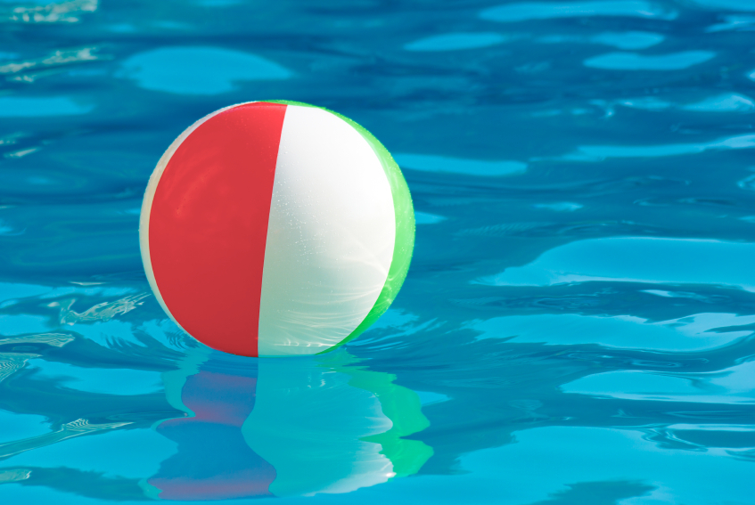 The ball may be the subject, but the placid blue water gives the ball cognitive, emotional, metaphoric buoyancy.