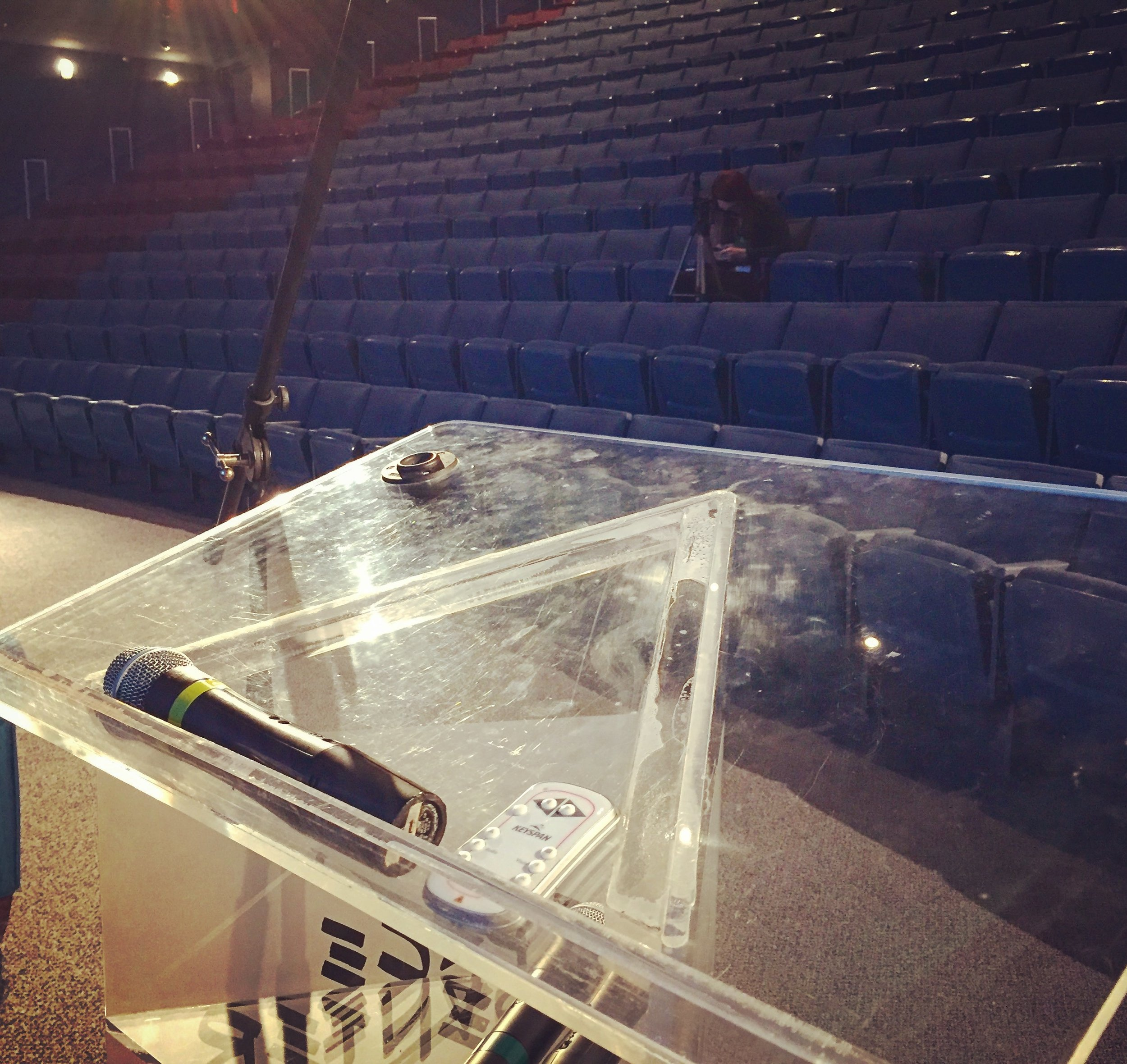It's looks like a podium, but it's really a place where reality gets condensed and amplified by focusing a crowd's attention.