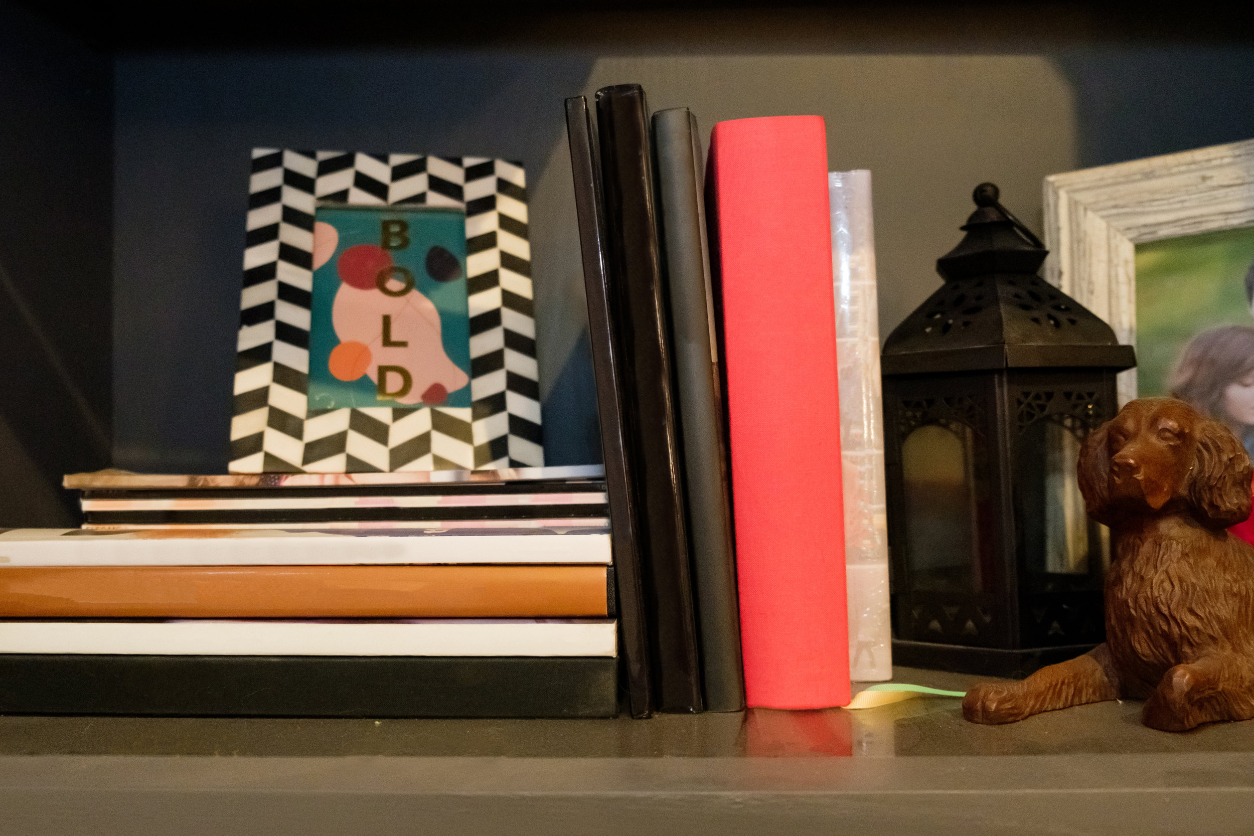 books on bookcase, desk, work area, library, living room, decor, decorations, shelf, decorated shelf, picture frame, home decor