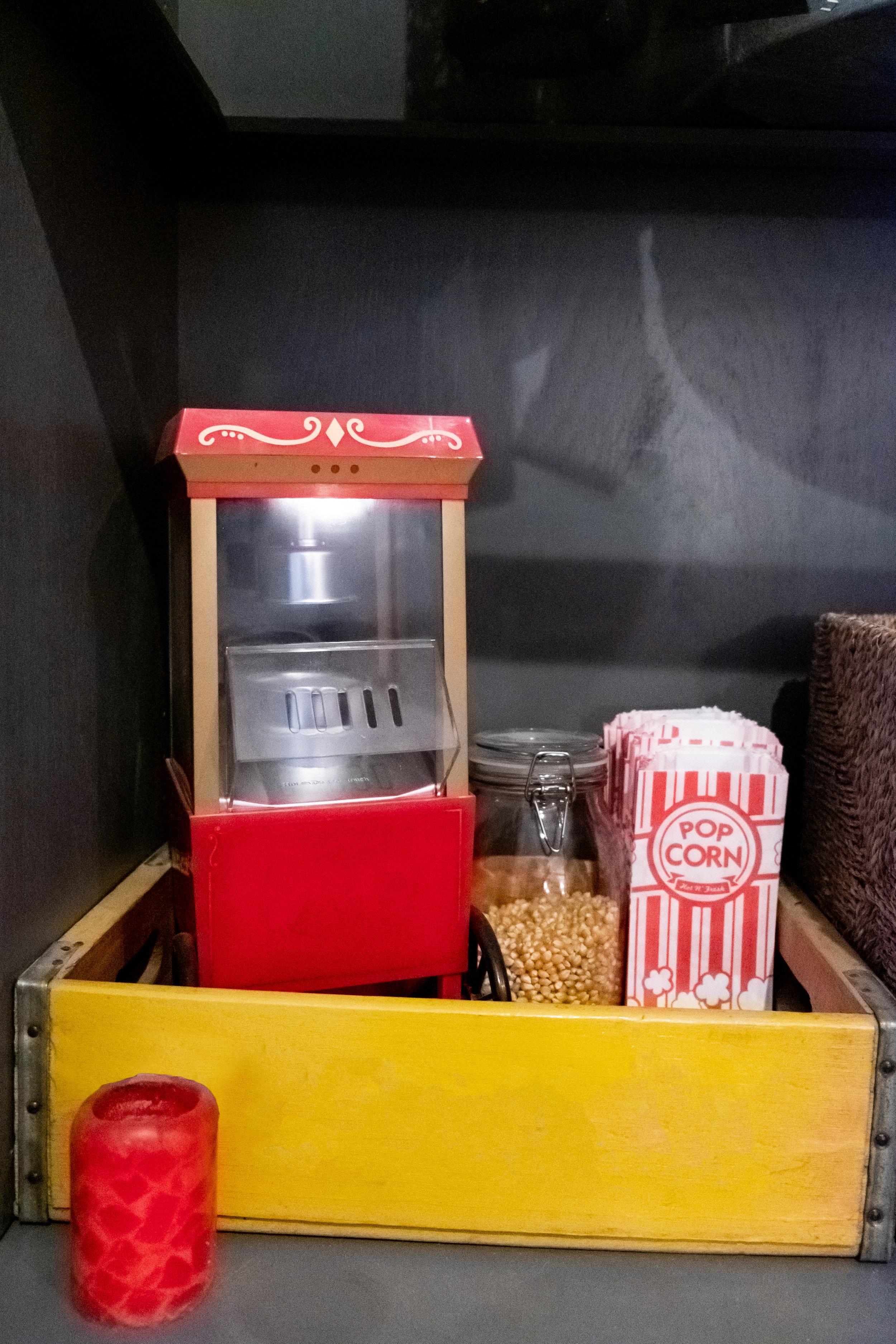 popcorn station, movie theatre media room, living room, red popcorn maker
