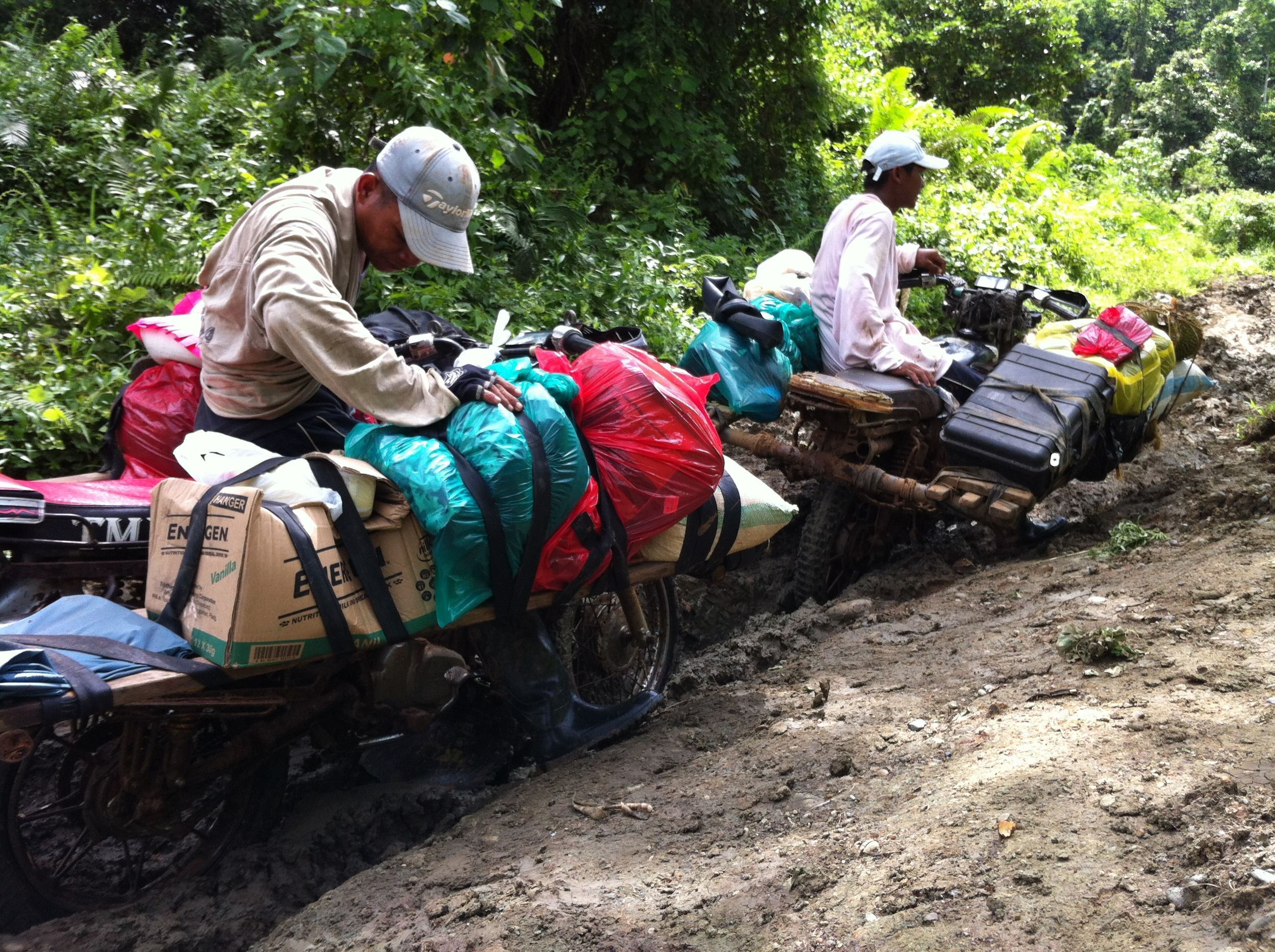 Transporting building materials up the mountains of Mindanao