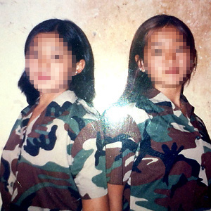 Anna and her sister in the army.
