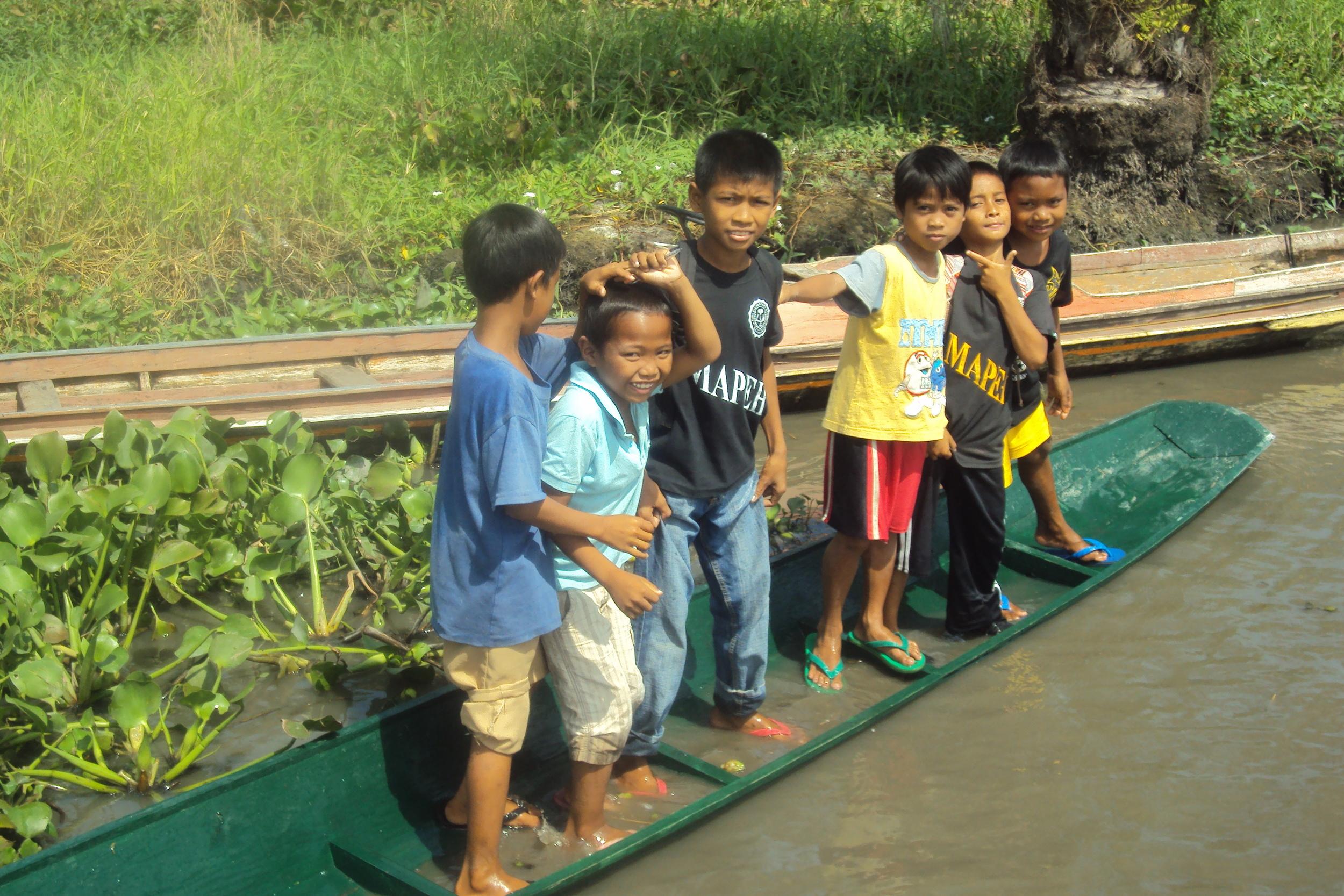 Kids in Sitio Paglat on boats.jpg