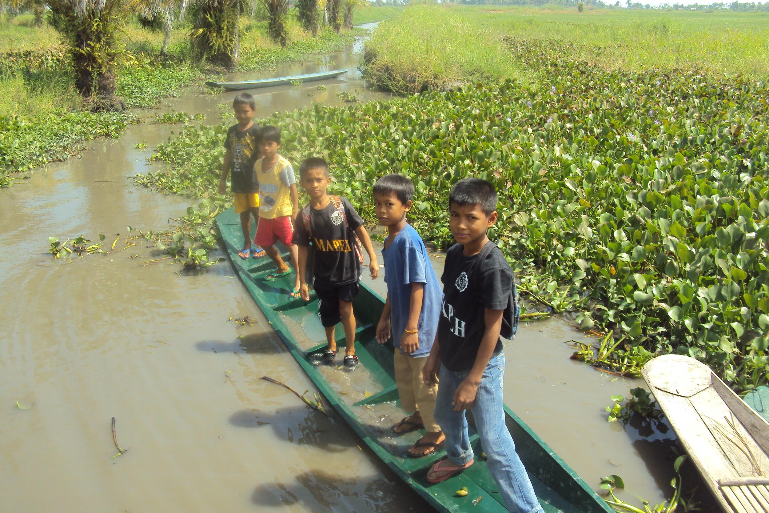 Kids in JPPF boats crossing swamps.jpg
