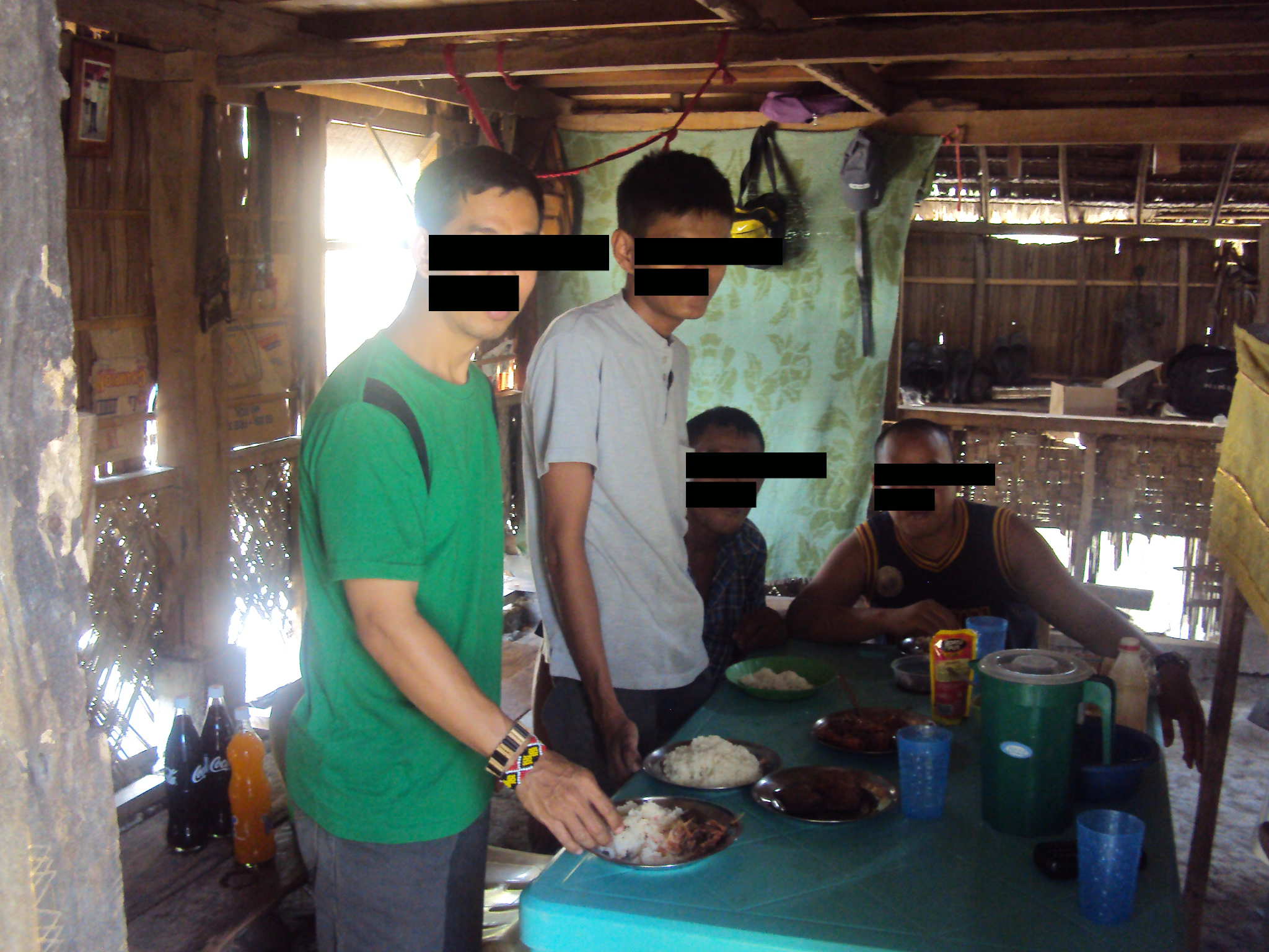 Glen having lunch with Halid and family censored 2.png