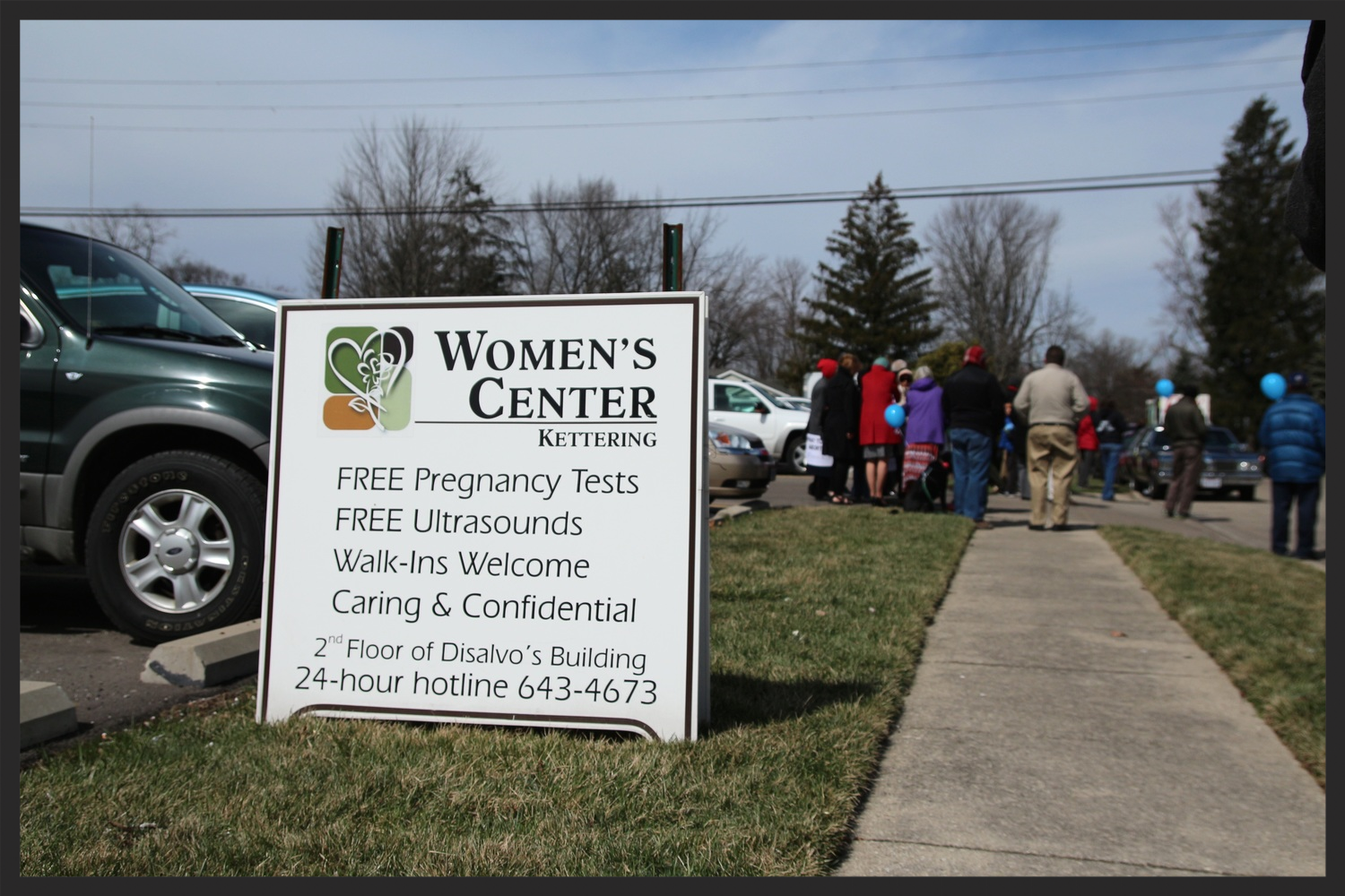 Women's Centers of Ohio owns the Crisis Pregnancy Center across the street from Dr. Haskell's Kettering Clinic. In this photo, their temporary sign is seen during the 40 Days for Life protest at the end of March. Their Kettering extension advertises free services, much like Miami Valley Women's Center.