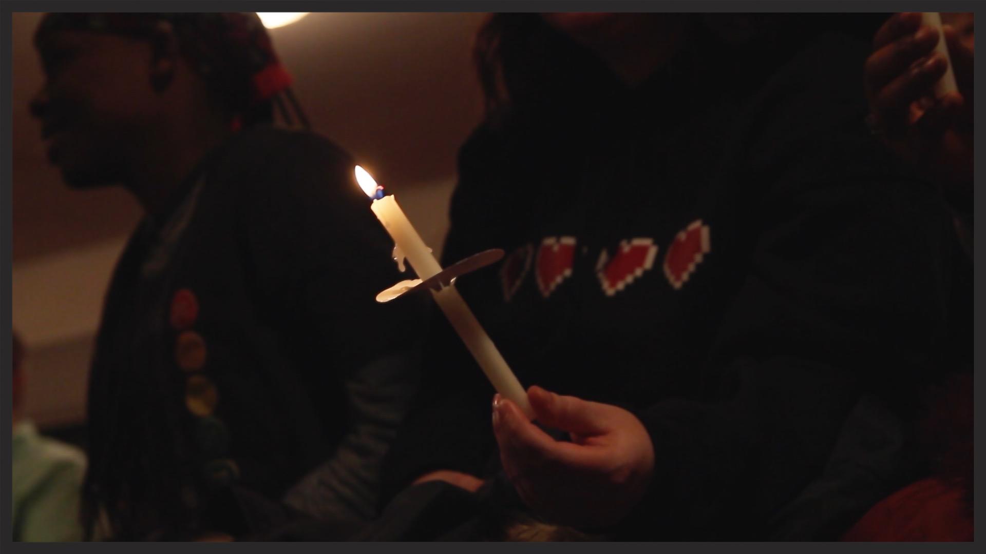 A candle is held during the vigil for Leelah Alcorn at Eternal Joy Metropolitan Community Church in January.