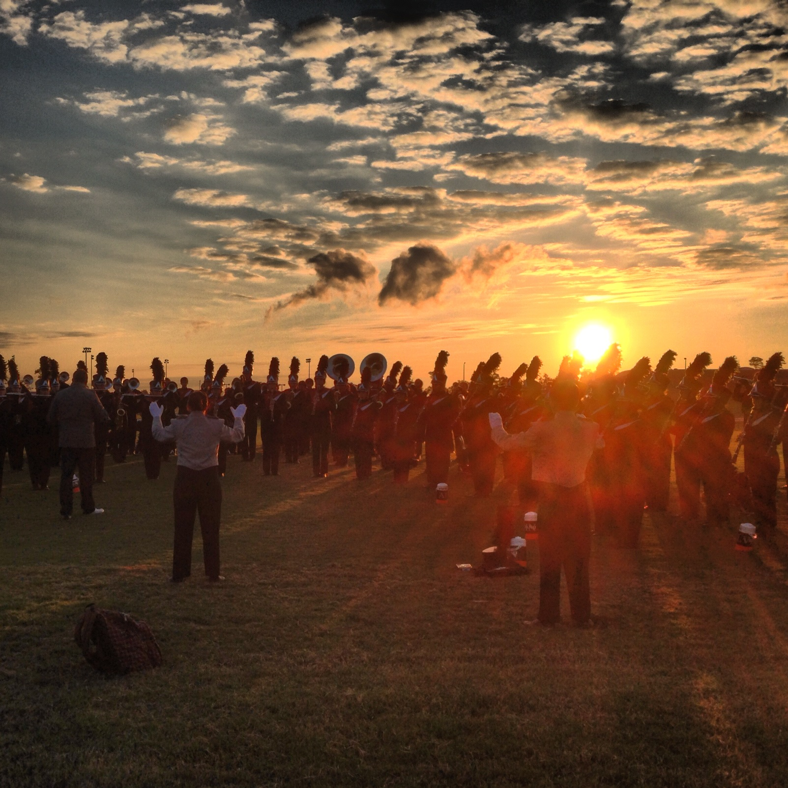 The sun rising over the band at the 2012 UIL Area F Marching Contest.