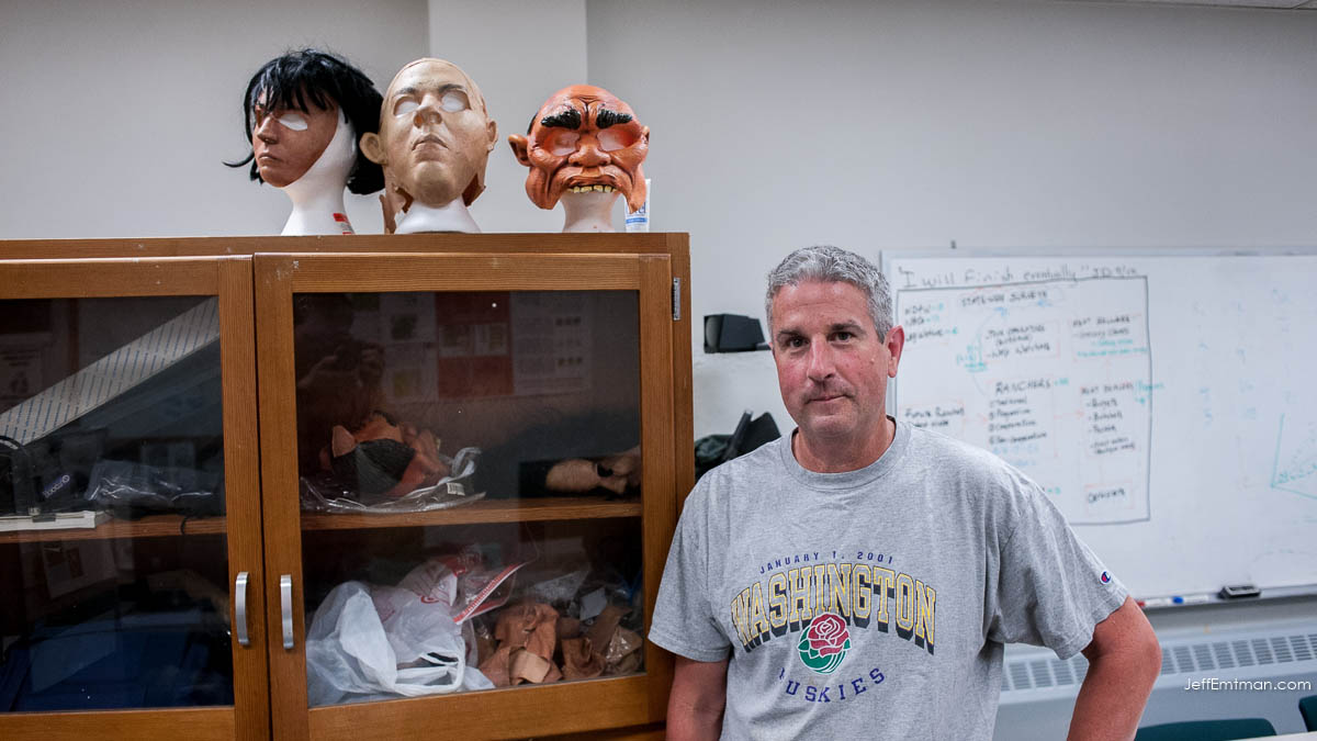 Crow researcher John Marzluff with 3 masks.