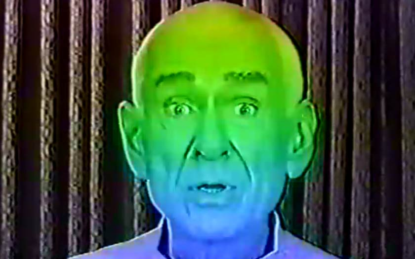 Screenshot of Marshall Applewhite speaking in a Heaven's Gate recruitment tape.   Abnormal coloration is due to VHS artifacts.