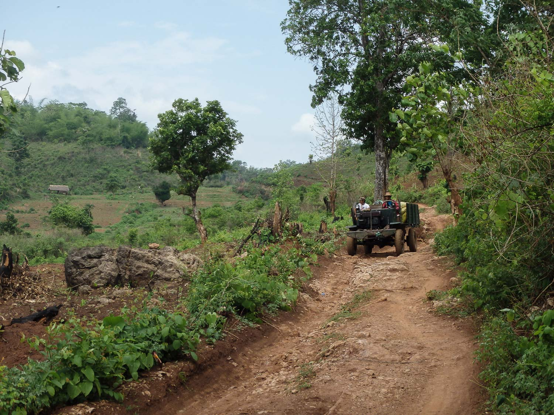 Trucks traveling on bumpy, dirt roads