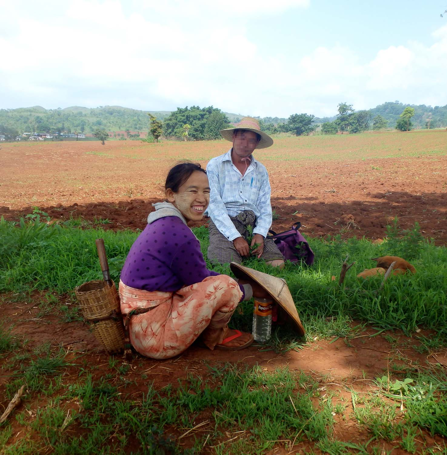 William stops to talk with a woman working in a field.