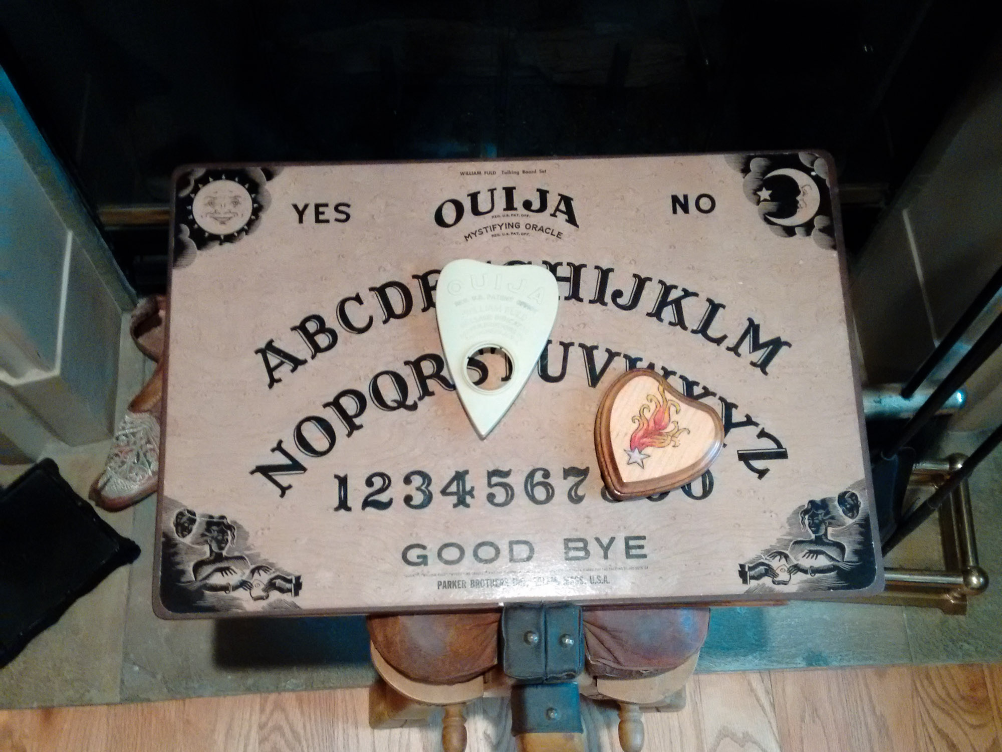 Ouija board in front of Patti's fireplace.