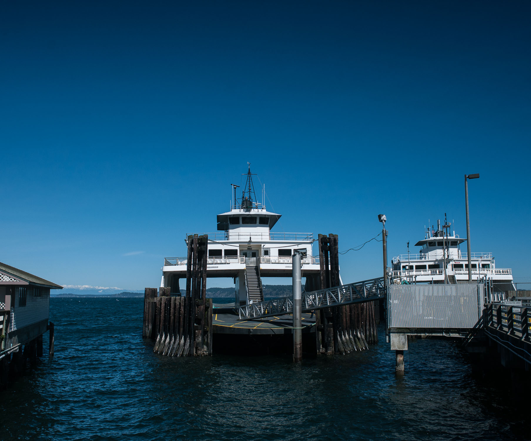 An empty boat meant for transporting vehicles at the Steilacoom Ferry Dock.