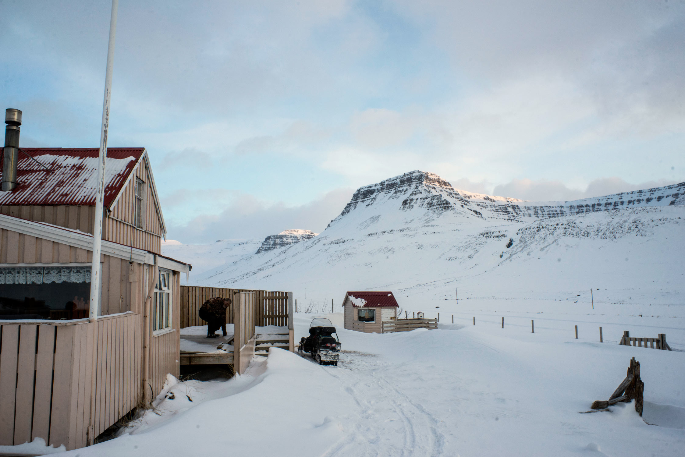 An Icelandic hunter, Jóhann Hannibalsson, at a remote cabin where he intends to shoot a fox.