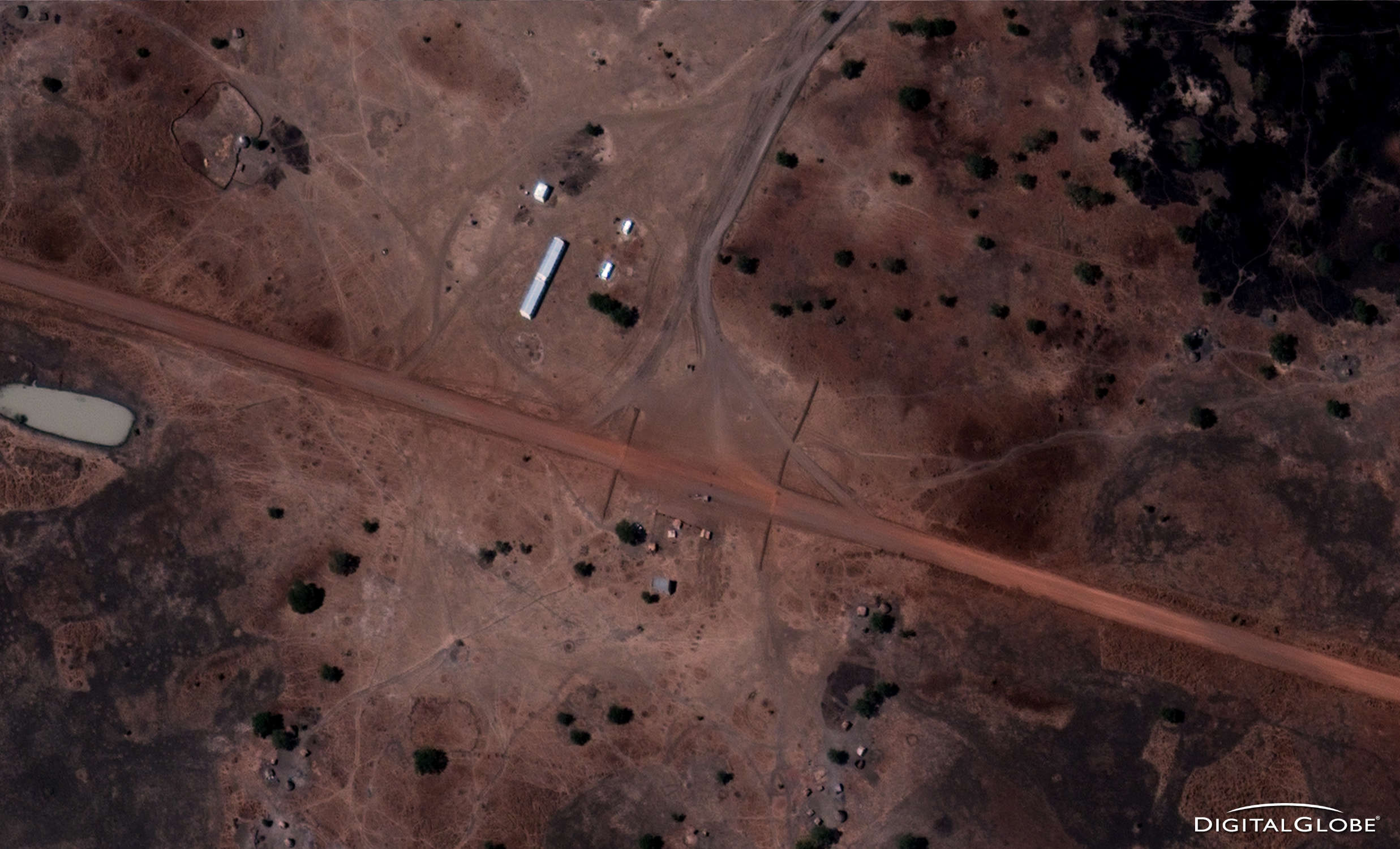 """Checkpoint with barriers north of Abyei Town on road to Diffra . January 13, 2011. From the Satellite Sentinel Project report """"Evidence of SAF Deployment in South Kordofan,"""" Image credit: DigitalGlobe."""
