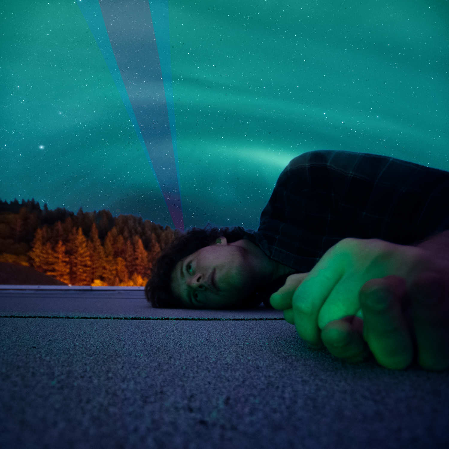 HBM host Jeff Emtman on the roof of his university's library in 2008.  Northern Lights image by  Johny Goerend  via Upsplash.