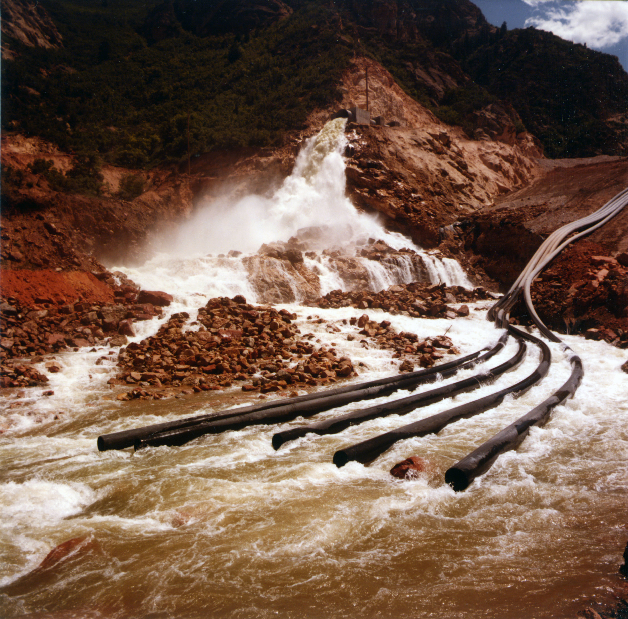 Water diversion projects to drain Thistle Lake in June 1983. Photo courtesy of the Utah State Archives and Records Service.