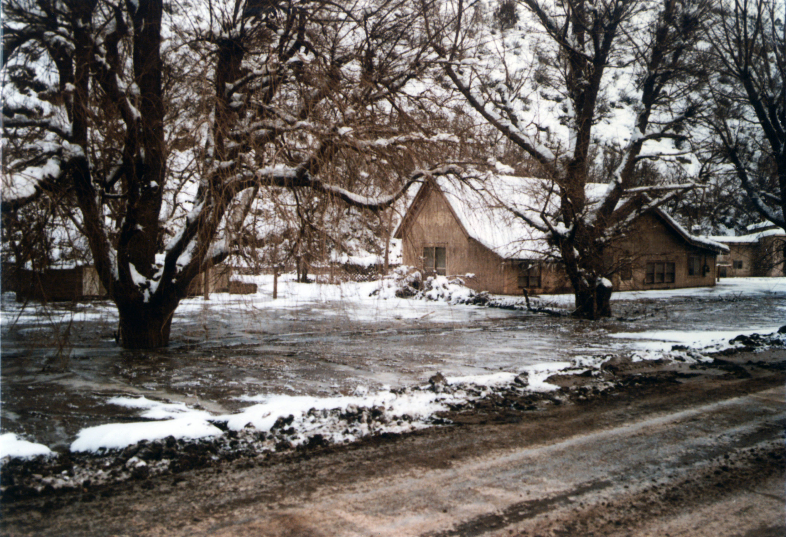 More buildings emerge as Thistle Lake is drained in December 1983. Photo courtesy of the Utah State Archives and Records Service.