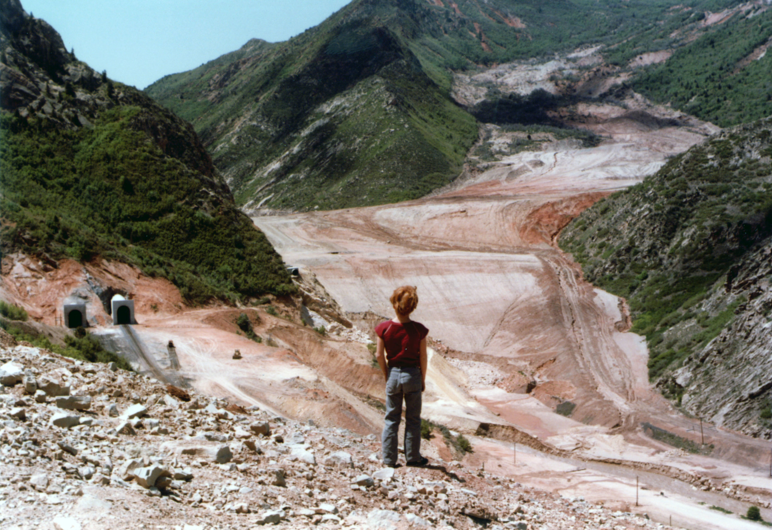 Unnamed youngster taking in the full scope of the Thistle mudslide (and new corresponding infrastructure) in May 1984. Photo courtesy of the Utah State Archives and Records Service.