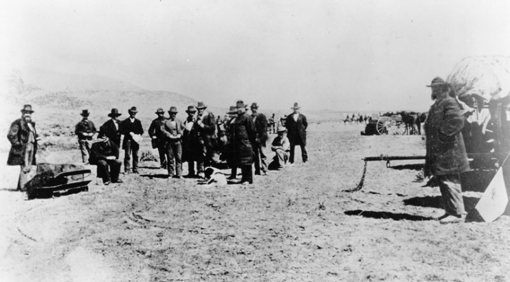 JOHN D. LEE (SEATED) AWAITING HIS EXECUTION AT MOUNTAIN MEADOWS ON MARCH 28, 1877 (SOURCE WIKIMEDIA COMMONS)