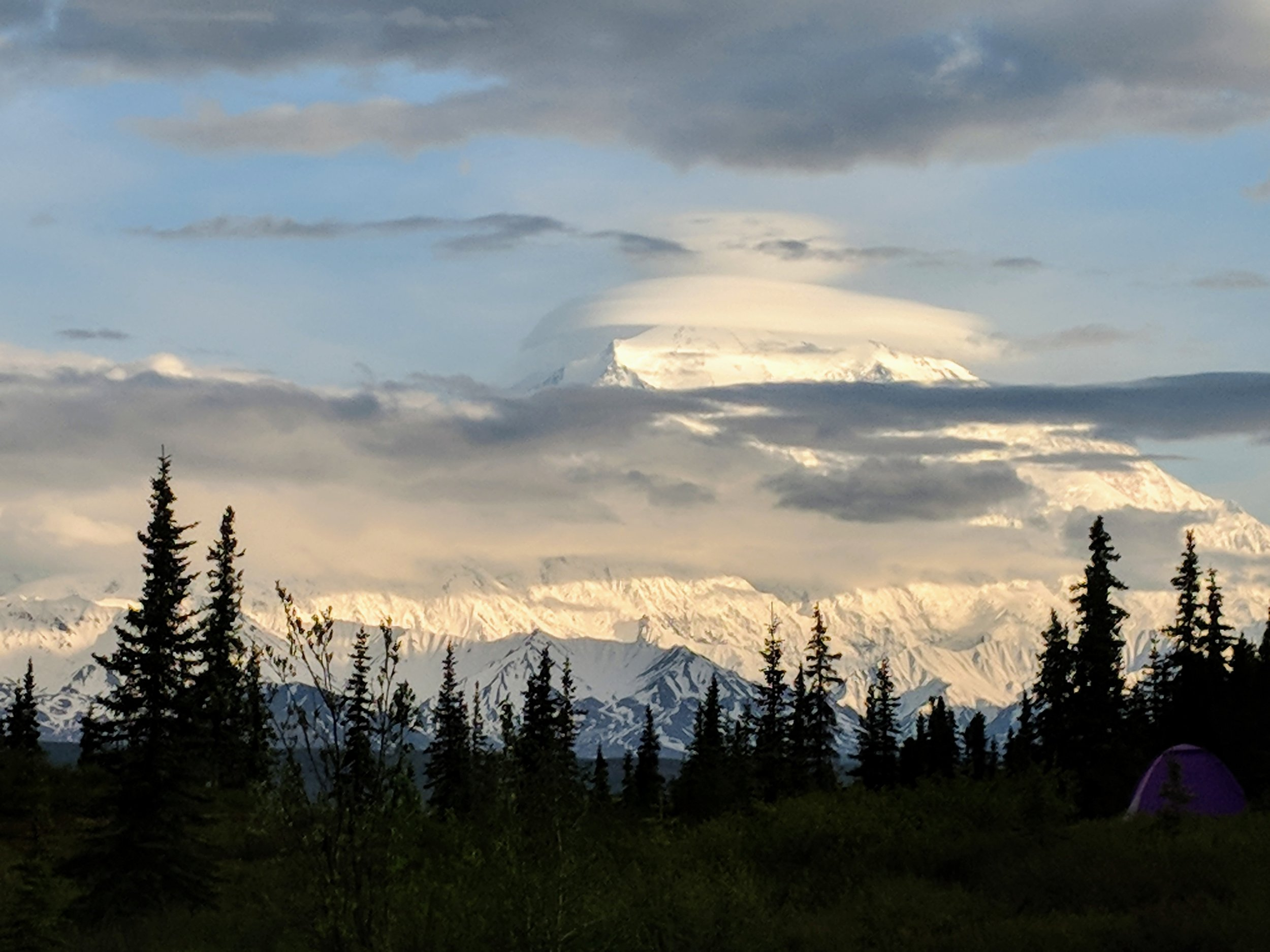 Denali through the clouds at the Wonder Lake Campground last summer.