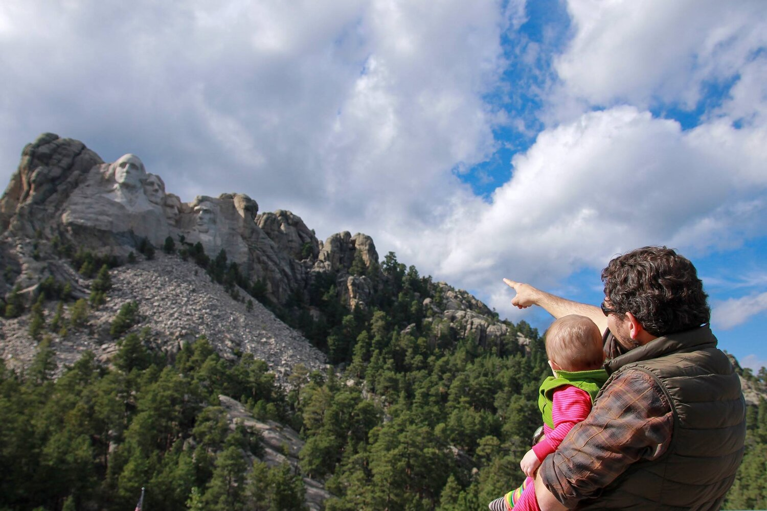 Showing my kiddo the sites on one of her first trips to the Black Hills several years ago.
