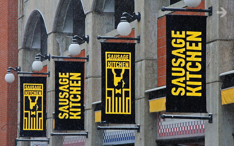 Banner Signage - Exterior banner system with congruent window appliques.