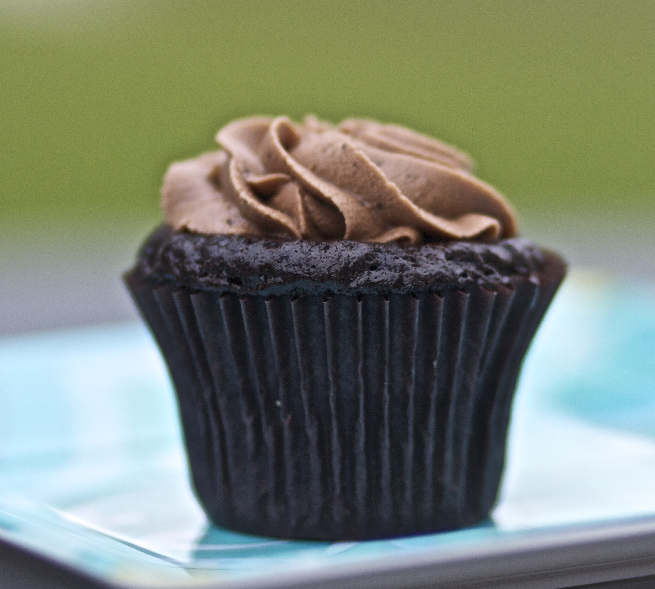 Gluten Free Chocolate Cake/Cupcake      2 cups sugar (I prefer raw)    1 ¾ cups Auntie's GF flour    ¾ cup cocoa    1 ½ tsp Baking Powder    1 ½ tsp Baking Soda    1 tsp sea salt    2 large eggs    1 cup coconut milk/rice milk or milk    ½ cup vegetable oil     2 tsp GF vanilla extract    1 cup boiling water      Preheat oven to 350. Prepare baking dishes      Combine dry ingredients in mixer. In a separate bowl, put all wet ingredients together and mix (except boiling water) Mix drys and wets together. Make sure not to over mix. Add boiling water to batter and mix well. Bake for 30-35 mins.  Makes 24 cupcakes or 2 – 9 inch rounds.