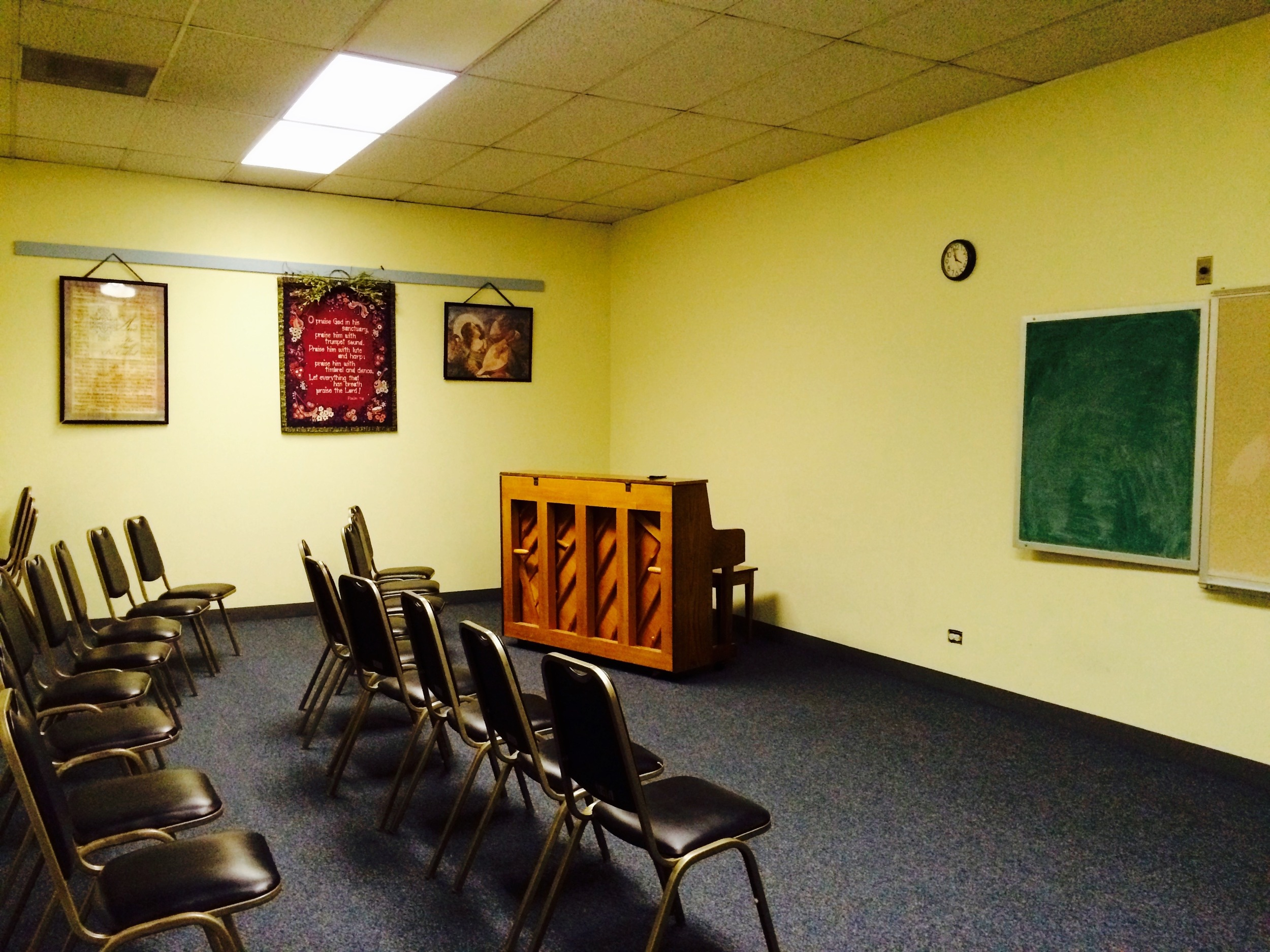 The music room has a piano, chairs, chalkboard, and usually folded-up tables in case you need to have a meeting. This is where the choir rehearses on Sundays, so you'll find lots of sheet music here too!