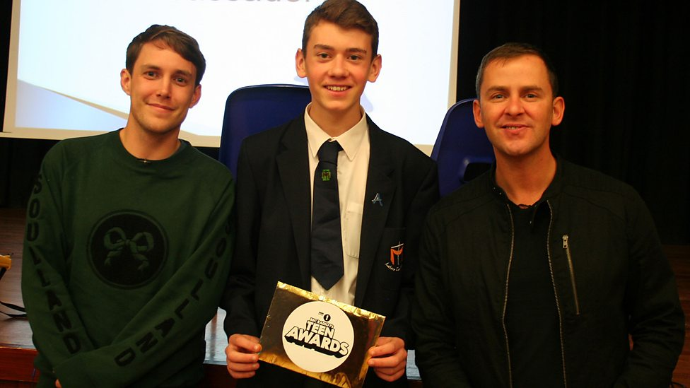 Radio 1 DJs Chris Stark and Scott Mills surprised Jack at his school to give him his award