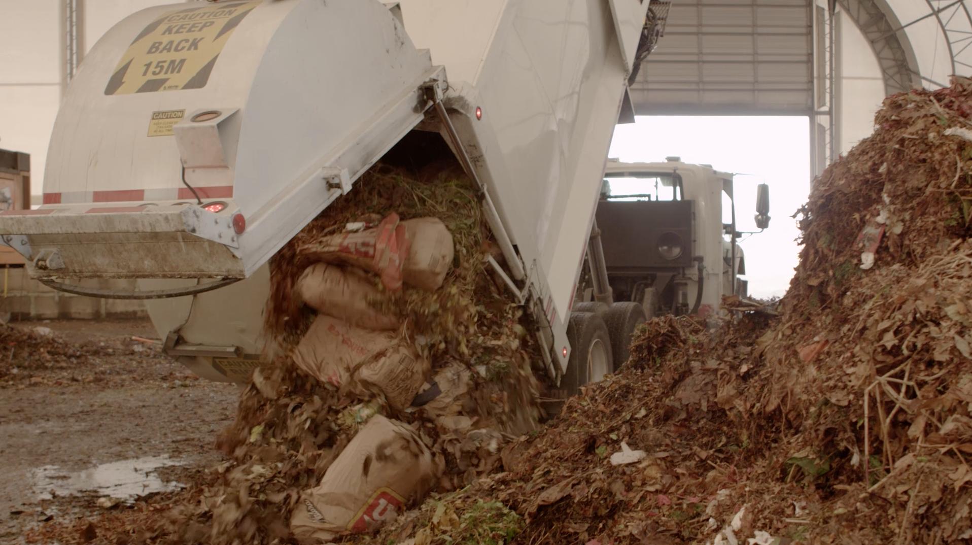 Net Zero Waste - Truck brings waste.png