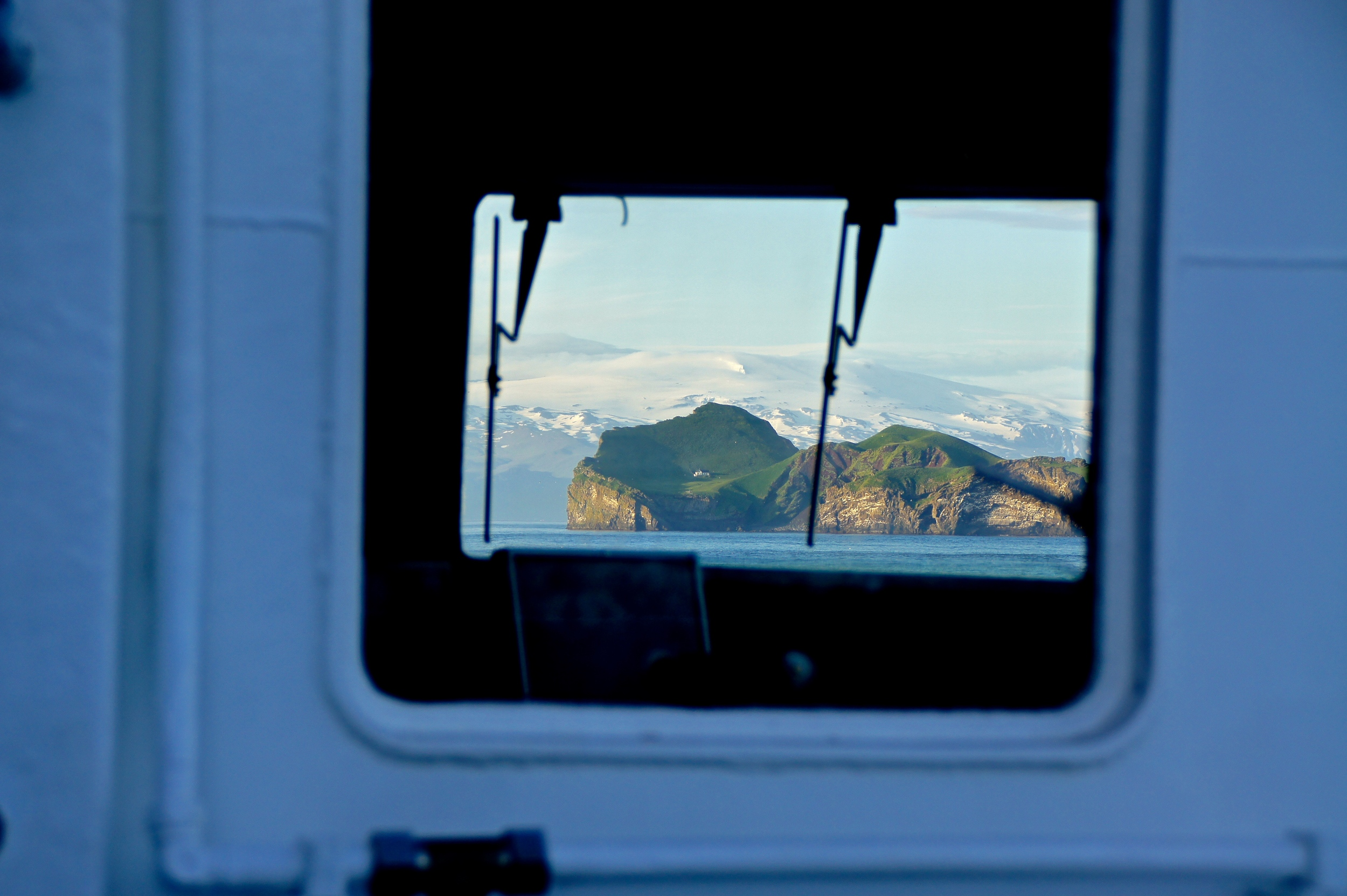 The view of one of the other islands with a hunting lodge on it, as seen through the window of the ferry.