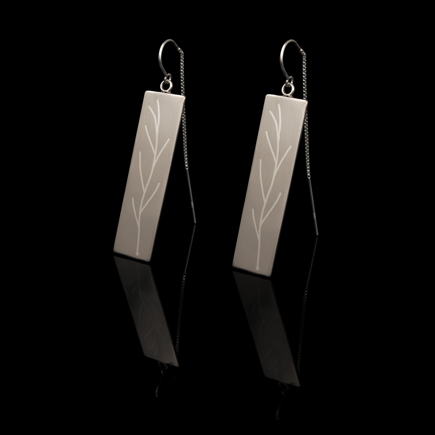A set of nickel and silver earrings from the Twigs Collection