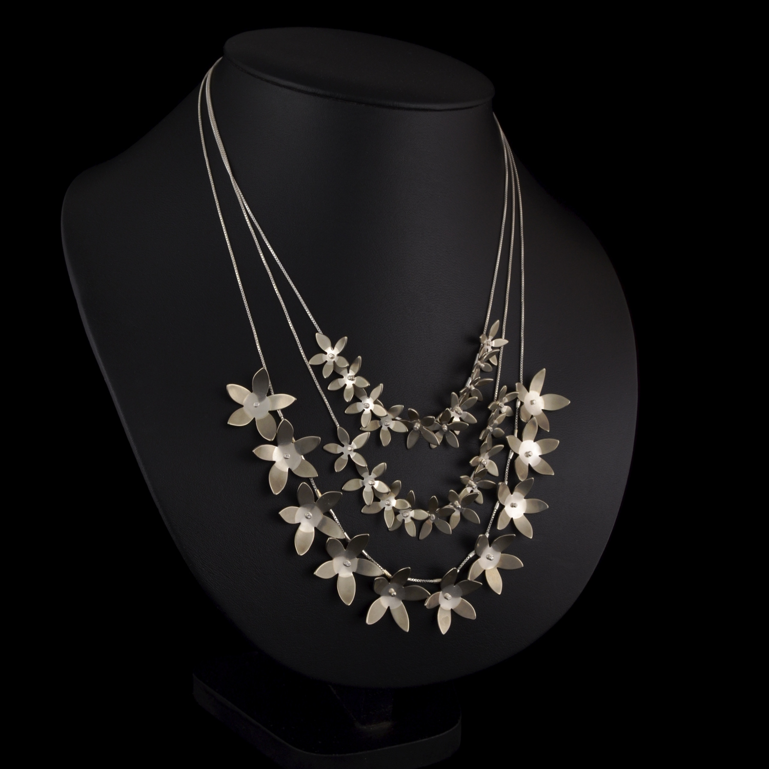 Multi-tiered flower necklace from the Flowers Collection. This necklace also separates so that it can be worn as single necklaces also.