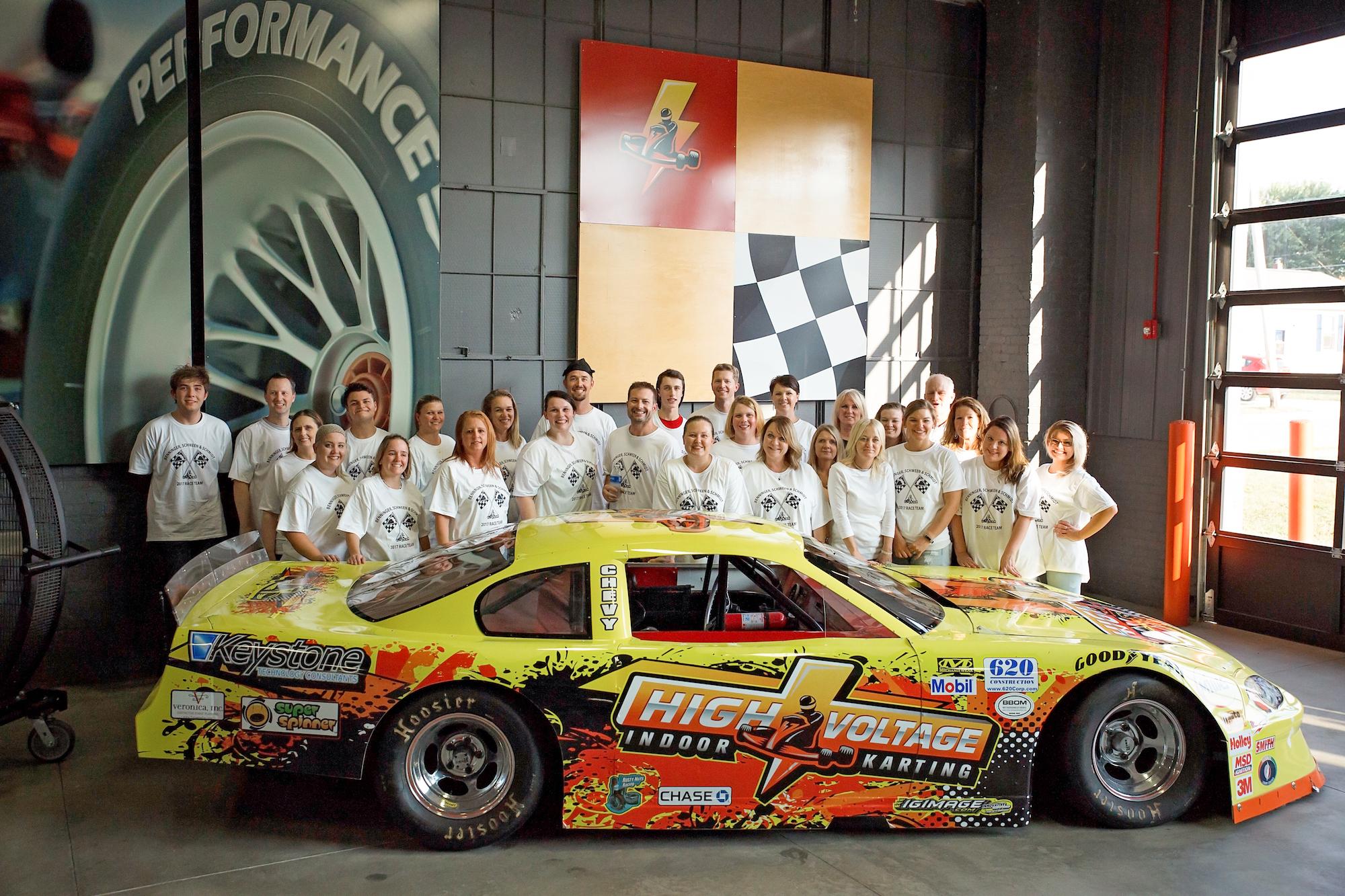 The Drs. Benninger, Schween, & Schmidt Team enjoy some high voltage indoor racing at a staff outing...