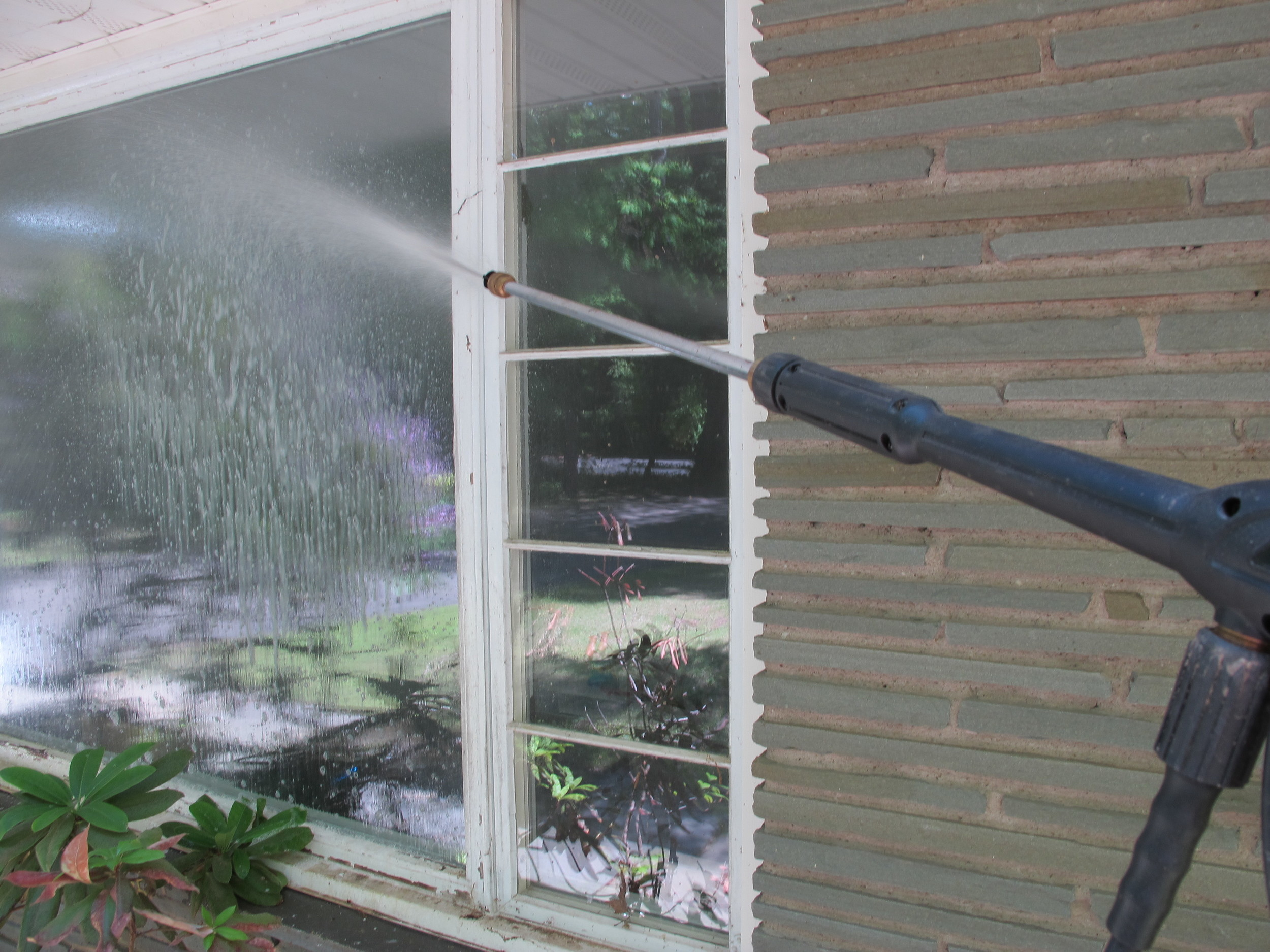 Orginal-Emily-Fazio_Clean-Windows-Pressure-Washer-spraying-soap.JPG