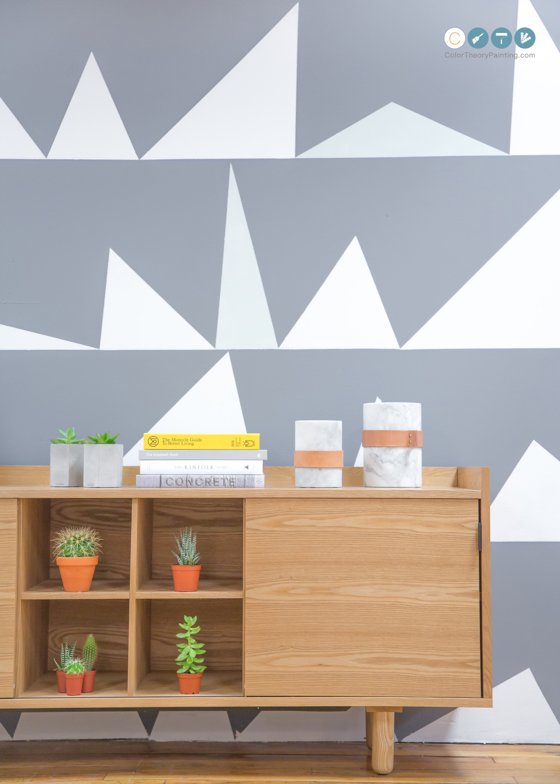 Triangles - Here's an image we found inspiration from on the web. The cool dark grey backdrop broken up and lightened by the unorthodox placement of scalene triangles.
