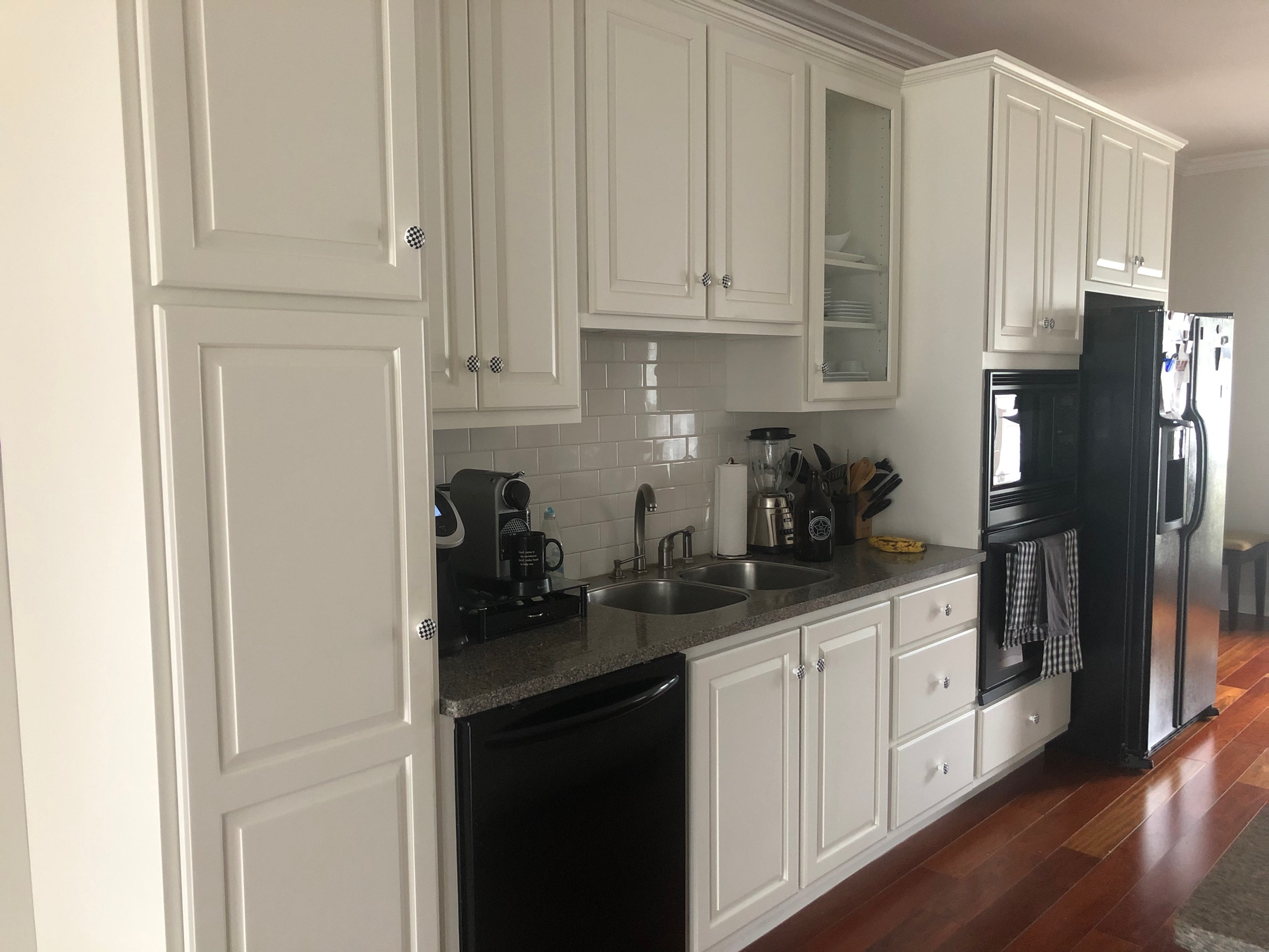 The open concept of this kitchen worked well in this downtown condo. A total remodel might have been overkill but painting gave the kitchen the update they were looking for.