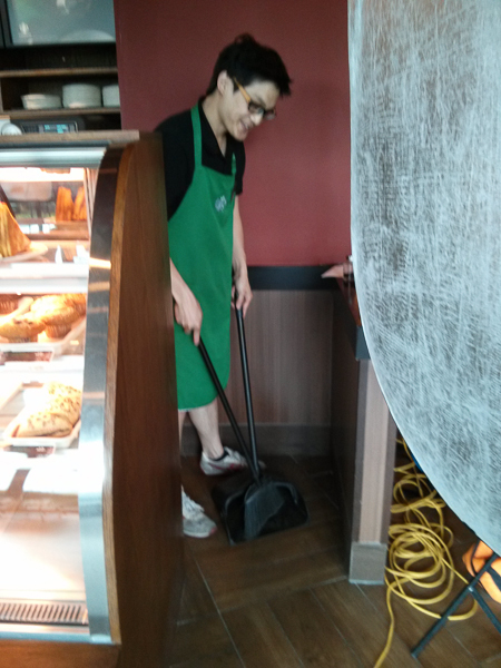 """Justin fulfilling his """"employee duties"""" by sweeping up the sprinkles after the shot was completed."""
