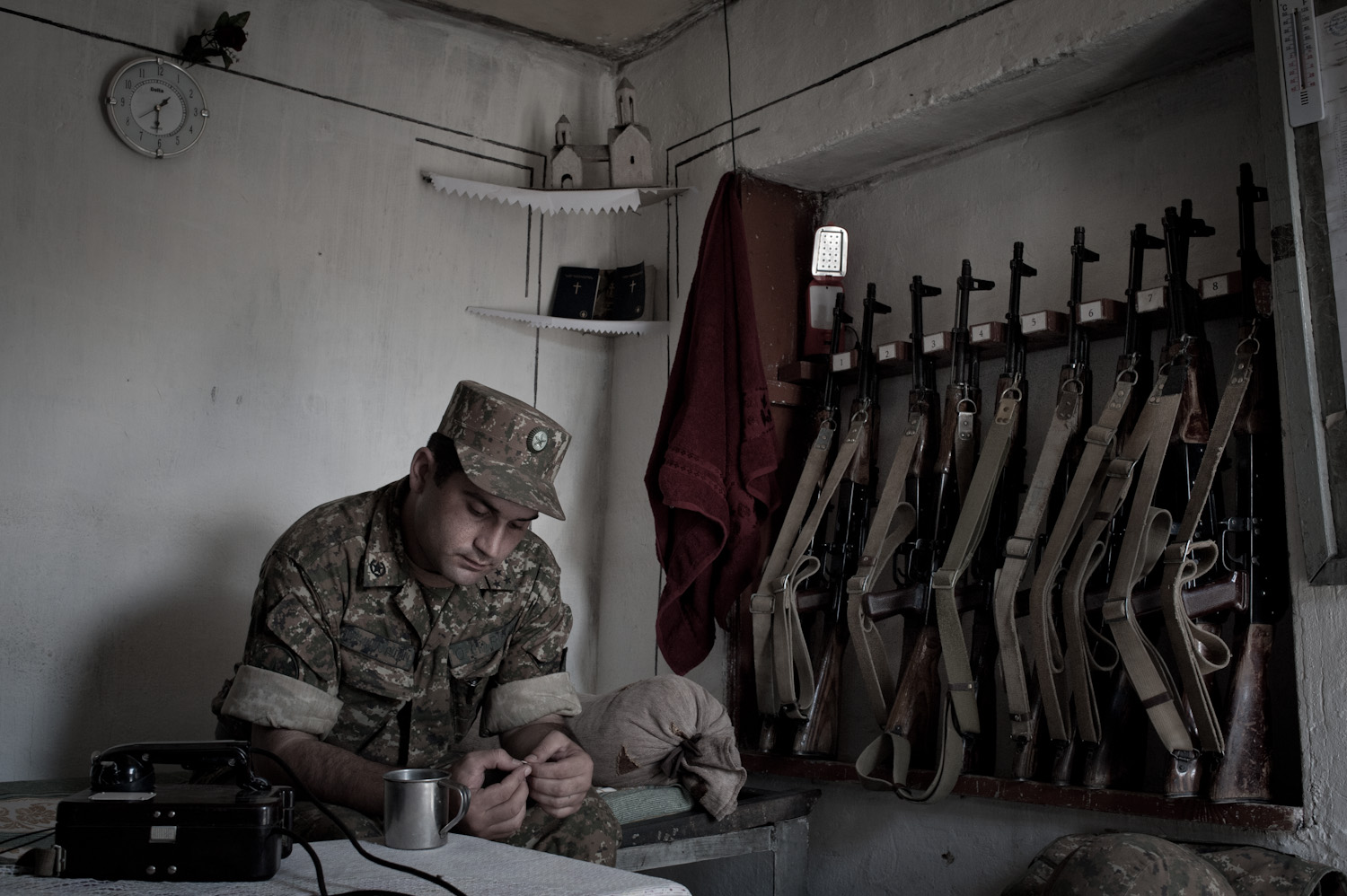 Commander Artur Mgrchyan rests in his dugout. He has been serving at the Mataghis frontline in Nagorno-Karabakh for the last 5 years.