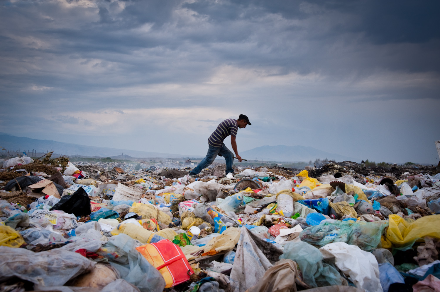 Grigor supports his wife and three children by rummaging daily in this garbage dump near Etchmiatzin for items to sell or to burn for fuel.