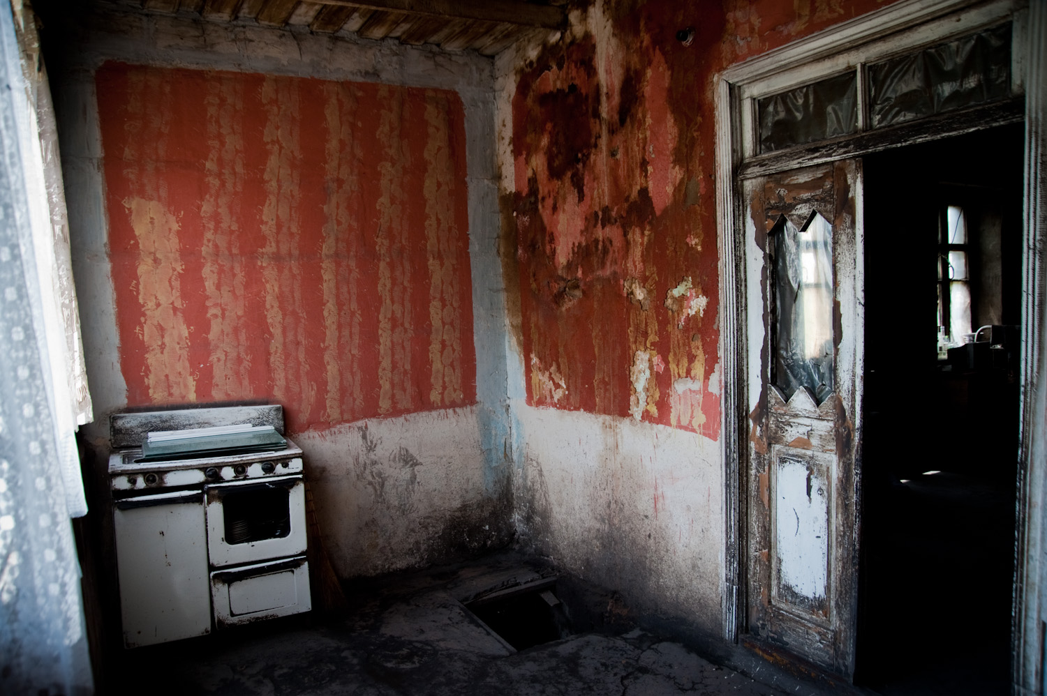 Nune owns only a stove and three iron bed frames with no mattresses. The walls of the family's home in Getap village have been blackened with soot. They get by on natural light because they cannot pay the electricity bill.
