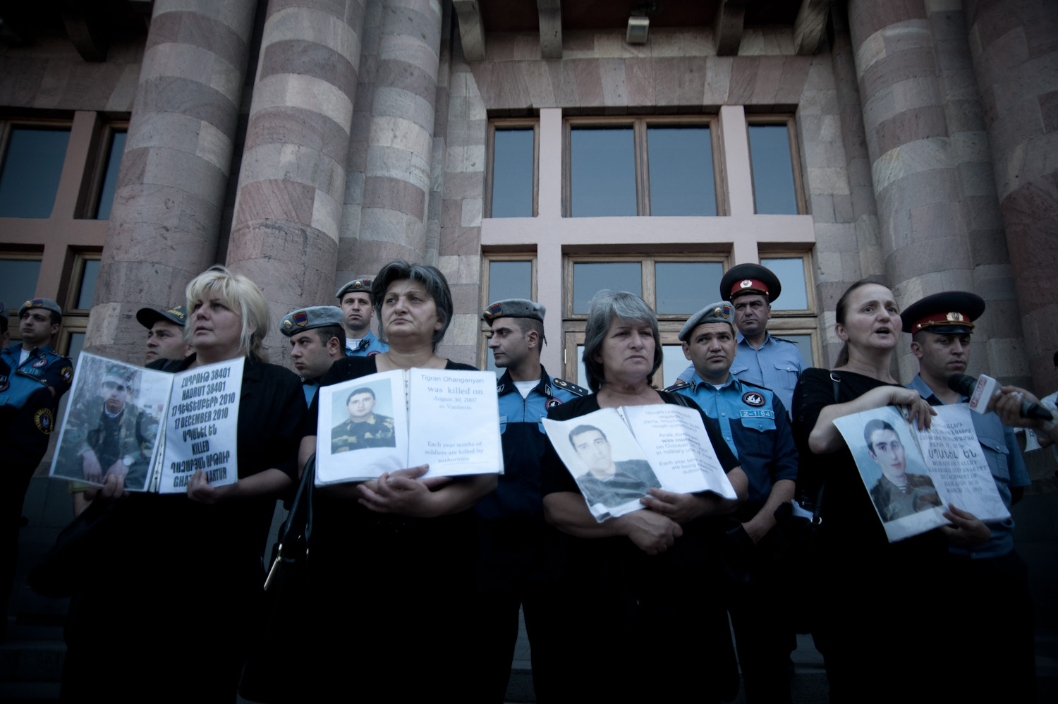 A group of soldiers' mothers stand in front of the government building at Yerevan's Republic Square every Thursday morning at 11am holding their sons' photographs and demanding that their cases be handled justly.