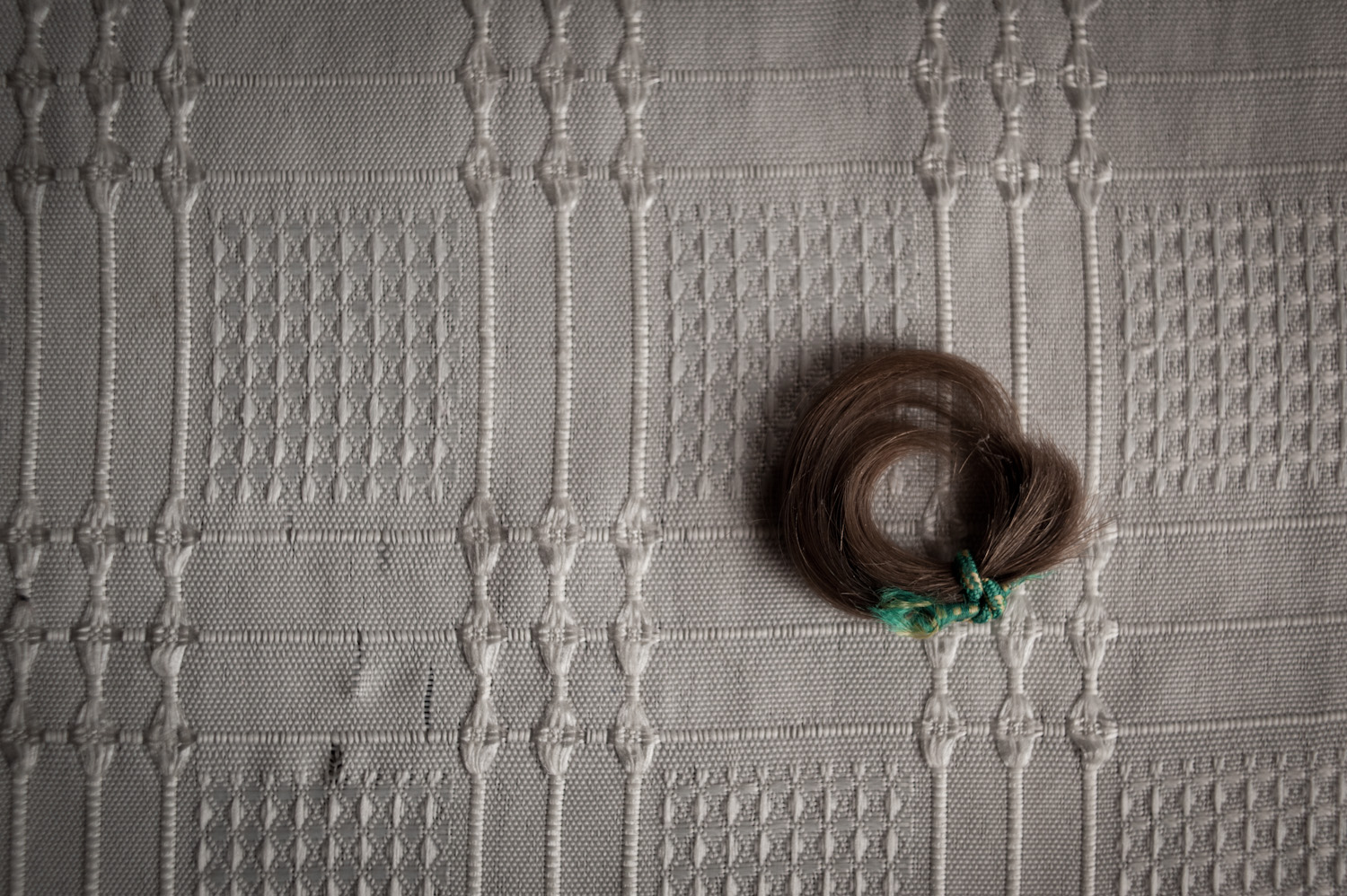Araik's mother keeps a tuft of her son's hair from his childhood.