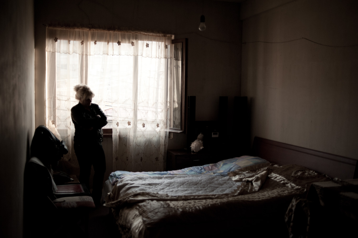 Irina's three sons all slept in the same room together. They have not removed the third bed from the room since his death.