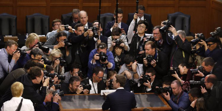 Media surrounds Mark Zuckerberg at Senate Judiciary testimony. Source:  Reuters / Leah Millis