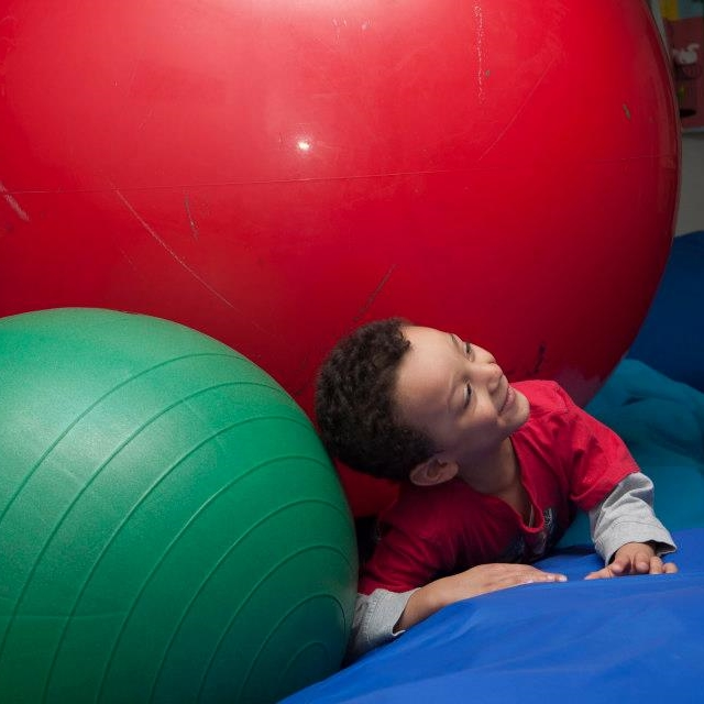 The biggest, red therapy ball. You can bounce on it, or just rest under it.  (photograph by Kate Milford)