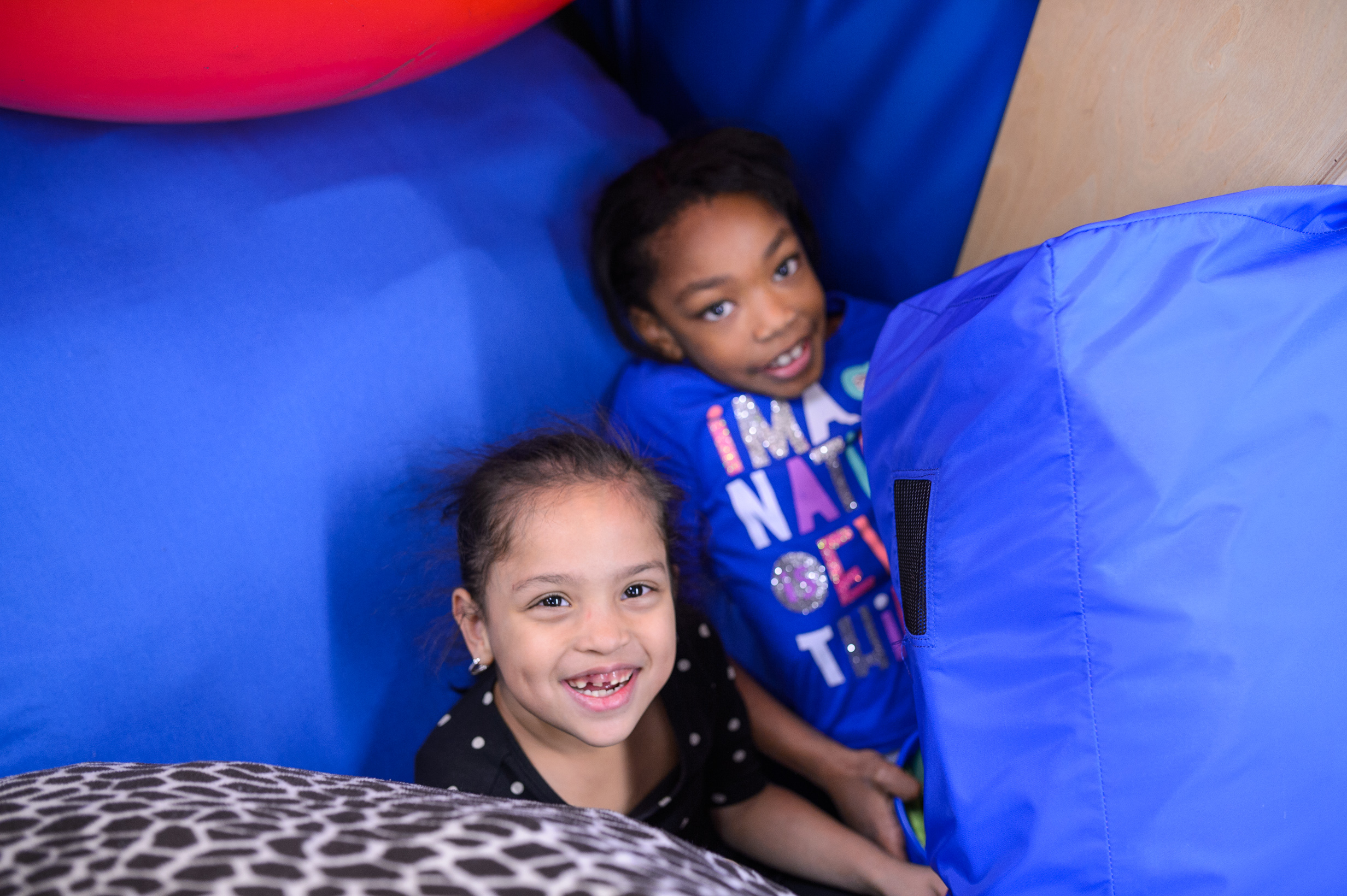 Two young girls at the sensory gym