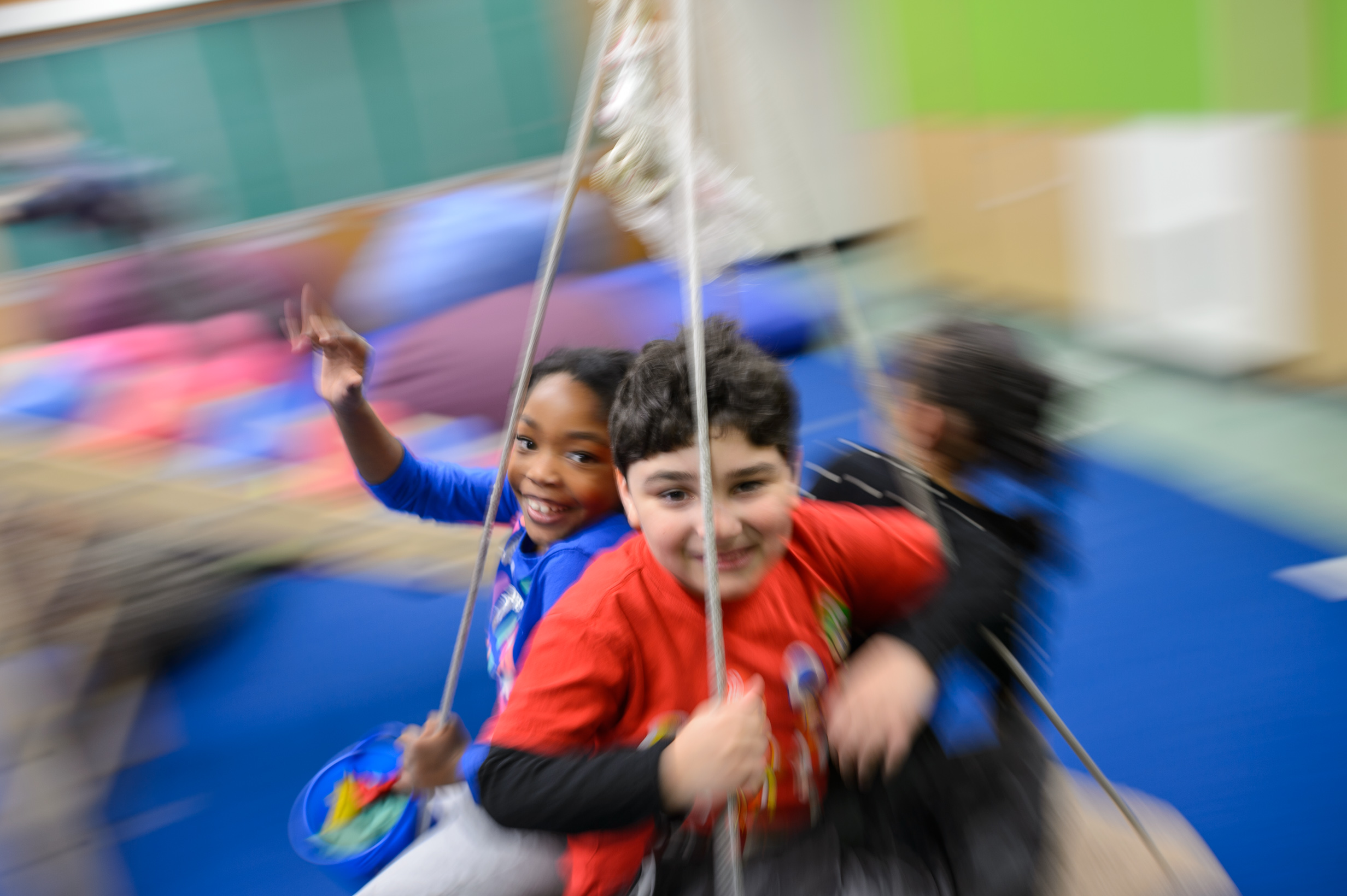 Children having some fun on the swing at after school